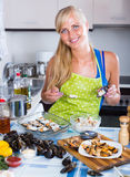 Woman preparing mussels with rice Stock Photos