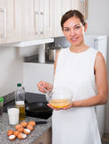Woman preparing omelet Royalty Free Stock Photos