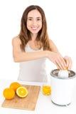 Woman preparing orange juice royalty free stock images