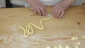 Woman preparing orecchiette e cavatelli with homemade pasta stock footage