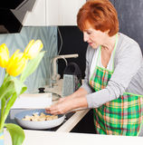 Woman preparing pasta with cheese Stock Images
