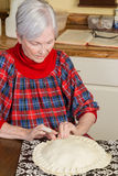 Senior Woman Preparing Pie Crust Stock Photo