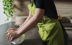 Woman preparing pink fondant for cake decorating, hands detail. Unrecognisable woman preparing white fondant for cake decorating, hands detail royalty free stock images