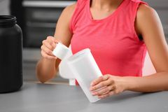 Woman preparing protein shake. Indoors Royalty Free Stock Photography
