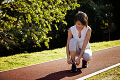 Woman preparing for the run tying shoe laces Royalty Free Stock Image