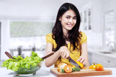 Woman is preparing salad royalty free stock photos
