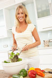 Woman Preparing Salad In Modern Kitchen Royalty Free Stock Photos