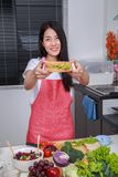 Woman preparing a sandwich in kitchen room royalty free stock images