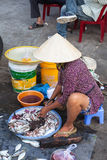 Woman is preparing seafood for sale at the market street Stock Photos