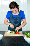 woman preparing sliced vegetables for dinner Stock Photo
