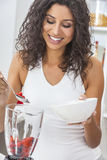 Woman Preparing Smoothie Fruit in Kitchen Blender Royalty Free Stock Photos