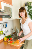 Woman preparing something to eat Stock Photography