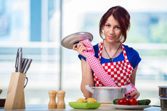 The woman preparing soup in the kitchen Stock Photo