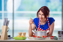 The woman preparing soup in the kitchen Stock Photos