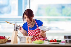 The woman preparing soup in the kitchen Royalty Free Stock Photography