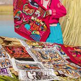 Woman preparing souvenirs in Uros, Peru, Bolivia. Stock Image