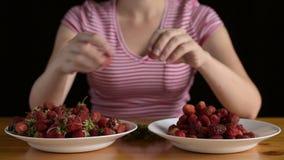 Woman preparing strawberries for jam stock video footage
