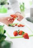 Woman preparing strawberries Royalty Free Stock Photos