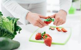 Woman preparing strawberries Stock Image