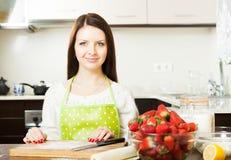 Woman preparing strawberry cake Royalty Free Stock Images