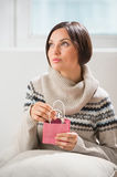Woman preparing surprise for her husband or boyfriend Stock Photo