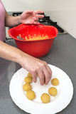 Woman preparing sweets in the kitchen Stock Images