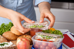 Woman preparing takeaway meal Royalty Free Stock Photography