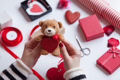 Woman preparing teddy bear toy and gift Royalty Free Stock Photography