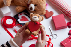 Woman preparing teddy bear toy and gift Royalty Free Stock Photos