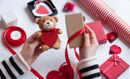 Woman preparing teddy bear toy and gift Stock Photo