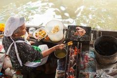 Woman preparing Thai kebab Royalty Free Stock Images