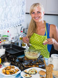Woman preparing tigres espanol with mussels indoors Stock Image