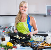Woman preparing tigres espanol with mussels indoors Stock Photography