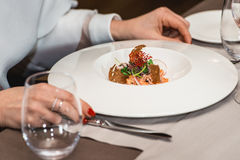 Woman is preparing to eat delicious salmon salad in a restaurant. small portion Stock Photos