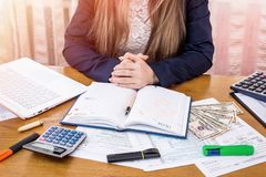 Woman preparing to fill 1040 form and for tax day.  royalty free stock photos