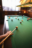 Woman preparing to hit pool ball. royalty free stock images