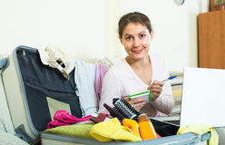 Woman preparing to travel Stock Photography