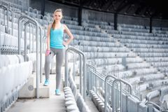 Woman preparing for training on stadium, stairs and fitness training - cross fit workout and running Royalty Free Stock Images