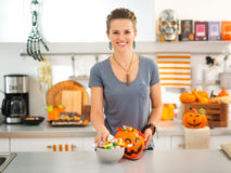 Woman preparing trick or treat candy for Halloween party Royalty Free Stock Image