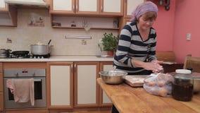 Woman Preparing Vareniki Or Dumplings Pierogi On Wooden Bord For Boiling. Cook Prepare Traditional Ukrainian Cuisine. Mother is making tasty dish for her stock video footage