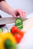 Woman preparing a vegetable salad Royalty Free Stock Photography