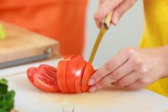 Free Woman Preparing Vegetables Salad Slicing Tomato Royalty Free Stock Images - 58771739