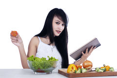 Woman preparing vegetables salad Stock Photography