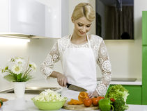 Woman preparing vegetarian salad Stock Images