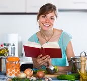 Woman preparing vegetarian soup on residential kitchen Stock Photography