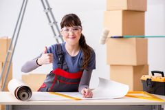 The woman preparing for wallpaper work. Woman preparing for wallpaper work Royalty Free Stock Image