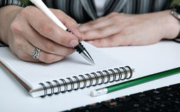 Woman is preparing for written work Stock Photos