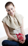 Woman with a present Royalty Free Stock Photography