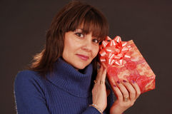 Woman with present Royalty Free Stock Images