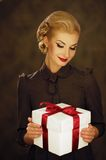 Woman with a present Stock Photography